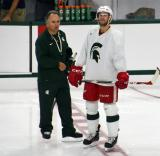 Tom Newton talks with Drew Miller during a session at the 2014 MSU Pro Camp.