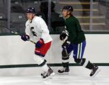 David Booth shadows Corey Tropp during a session at the 2014 MSU Pro Camp.