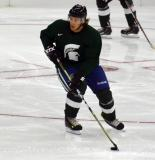 David Booth carries the puck during a session at the 2014 MSU Pro Camp.