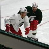 Justin Abdelkader and Drew Miller race along the boards during a session at the 2014 MSU Pro Camp.