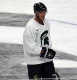 Corey Potter stands near center ice during a session at the 2014 MSU Pro Camp.