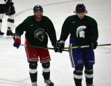 Andrew Rowe and David Booth laugh during a stop in a session at the 2014 MSU Pro Camp.