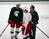 Drew Miller and Justin Abdelkader talk to Tom Newton during a session at the 2014 MSU Pro Camp.