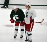 Drew Miller and Justin Abdelkader talk at the end of a session at the 2014 MSU Pro Camp.