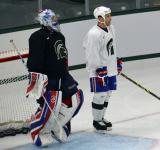 Joel Martin and Mike Weaver stand next to each other at the crease during a session at the 2014 MSU Pro Camp.