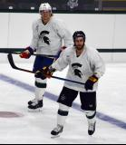 Jeff Petry and Patrick Eaves skate at the blue line during a session at the 2014 MSU Pro Camp.