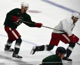 Jakub Kindl hooks Drew Miller during a session at the 2014 MSU Pro Camp.