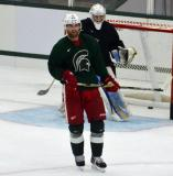Jakub Kindl sets up in front of Jeff Lerg during a session at the 2014 MSU Pro Camp.