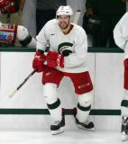 Drew Miller steps onto the ice during a session at the 2014 MSU Pro Camp.