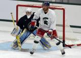 Andrew Rowe sets up in front of Jeff Lerg during a session at the 2014 MSU Pro Camp.