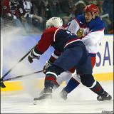 Pavel Datsyuk jumps to avoid Team USA's Brian Leetch while playing for Team Russia in the 2002 Olympic Winter Games.