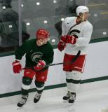 Daniel Cleary and Danny DeKeyser skate behind the net during a session at the 2014 MSU Pro Camp.