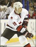 Steve Yzerman looks to make a cross-ice pass while playing for Team Canada in the 2002 Olympic Winter Games.