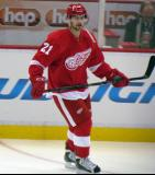 Tomas Tatar stands near the boards during pre-game warmups before a preseason game.