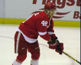 Andrej Nestrasil reaches for a puck during pre-game warmups before a preseason game.