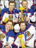 Sergei Fedorov poses with Team Russia teammates Darius Kasparaitis, Alexei Kovalev, and Nikolai Khabibulin after winning the Bronze Medal in the 2002 Olympic Winter Games.