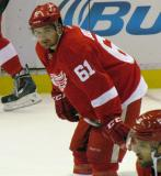 Xavier Ouellet crouches during pre-game warmups before a preseason game.