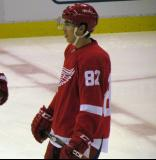 Tomas Nosek stands at center ice during pre-game warmups before a preseason game.