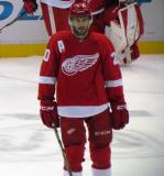 Drew Miller stands in the neutral zone during pre-game warmups before a preseason game.