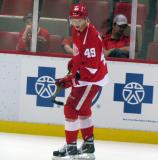 Andrej Nestrasil balances a puck on his stick blade during pre-game warmups before a preseason game.