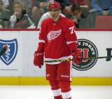Andreas Athanasiou stands near the boards during pre-game warmups before a preseason game.