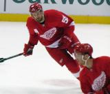 Niklas Kronwall skates in the neutral zone during pre-game warmups before a preseason game.