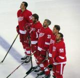 Jonathan Ericsson, Daniel Cleary, Drew Miller, Joakim Andersson and Niklas Kronwall stand at the blue line for the singing of The Star-Spangled Banner.