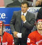 Assistant Coach Tony Granato stands behind the bench during a preseason game.