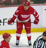 Alexey Marchenko crouches before a faceoff during a preseason game.