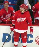 Daniel Cleary stands at the boards in front of the bench during a stop in a preseason game, with Colin Campbell over his shoulder.