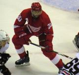 Drew Miller comes off the wing on a faceoff during a preseason game.