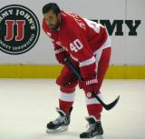 Henrik Zetterberg crouches near the boards during pre-game warmups.
