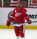 Johan Franzen stands on the ice during pre-game warmups.