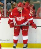 Brendan Smith crouches at the boards during pre-game warmups.
