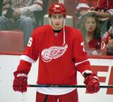 Tomas Jurco stand at the boards during pre-game warmups.