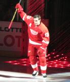 Pavel Datsyuk raises a stick to the crowd during player introductions at the Red Wings' 2014 home opener.