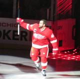 Henrik Zetterberg raises a stick to the crowd during player introductions at the Red Wings' 2014 home opener.