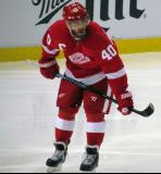Henrik Zetterberg crouches during a stop in play.