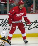 Brendan Smith stands along the boards during a stop in play.
