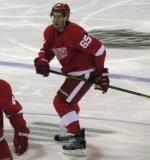 Danny DeKeyser retreats through center ice.