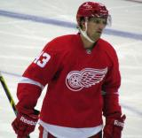 Darren Helm skates back to the bench during a stop in play.