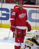 Drew Miller looks down ice during a stop in play.