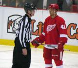 Luke Glendening stands near linesman Jean Morin during a stop in play.