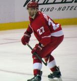 Kyle Quincey skates into his own zone.