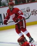 Riley Sheahan skates near the boards.