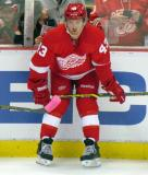 Darren Helm crouches at the boards during pre-game warmups.