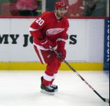 Drew Miller skates with the puck during pre-game warmups.