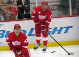 Johan Franzen and Darren Helm skate during pre-game warmups.