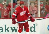 Tomas Jurco stands at the boards during pre-game warmups.