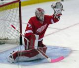 Jimmy Howard gloves down a shot during pre-game warmups.